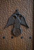 Double Headed Eagle Emblem on Hammered Wood Background