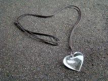 Double Heart. On black sand Stock Photos