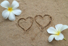 Double heart drawn on sand Stock Image