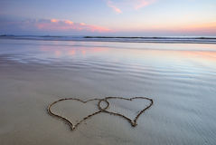 Double heart shape on the beach Stock Photo