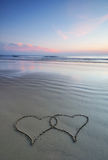 Double heart shape on the beach Royalty Free Stock Image