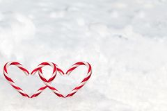 Double Heart Shape Candy Canes in the Snow Royalty Free Stock Images