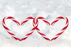 Double Heart Shape Candy Canes in the Snow Royalty Free Stock Photos