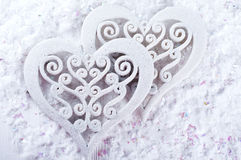 Double heart shape in the snow Royalty Free Stock Photos