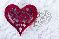 Double heart shape in the snow Royalty Free Stock Image