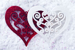 Double heart shape in the snow Royalty Free Stock Photo