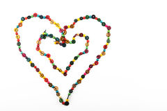Double heart shaped colorful beads necklace isolated on white Royalty Free Stock Photo