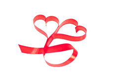 Double heart shaped red ribbon close up Stock Images