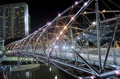 Double-Helix Bridge. A night photo of the Helix Bridge at the Marina Promenade in Singapore Royalty Free Stock Images