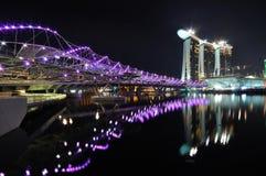 Double helix bridge and Marina Integrated Resorts. Newly constructed double helix bridge at Singapore Marina Bay Royalty Free Stock Photography