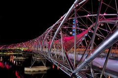 Double Helix Bridge. Night view of the Double Helix Bridge at Marina Bay, Singapore; designed based on the human DNA structure Royalty Free Stock Image