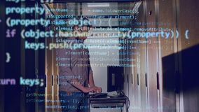 Double image of the engineer working on the laptop and the computer code