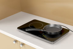 Double induction cooktop and frying pan Stock Photo