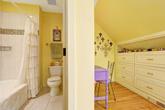 Double kids bathroom interior with storage cabinet and table stock image