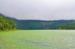Double lake on the island of San Miguel - green lake. Double lake Lagoa das Sete Cidades in the clouds on the island of San Miguel, Azores - green lake royalty free stock photo