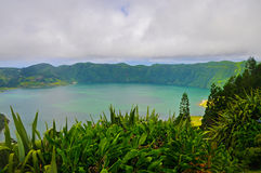 Double lake on the island of San Miguel. Double lake Lagoa das Sete Cidades in the clouds on the island of San Miguel, Azores royalty free stock photography