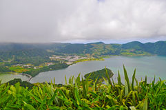 Double lake on the island of San Miguel. Double lake Lagoa das Sete Cidades in the clouds on the island of San Miguel, Azores stock image