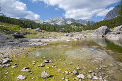 Double Lake at Triglav Lakes Valley. Lake in the foreground, mountain range in the background Royalty Free Stock Photo