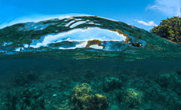 Double landscape with sea and sky. Sea water split photo. Undersea view of coral. Stock Photography