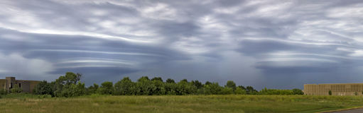 Double Laterals. Two lateral cloud formations over a field in Minnesota Royalty Free Stock Photos