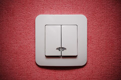 Double light switch against red wall. Closeup Royalty Free Stock Photography