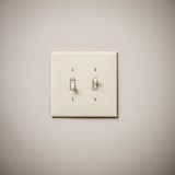 Double Lightswitch sur le mur blanc Photos libres de droits