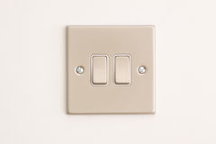Double Lightswitch on a White Wall Stock Images