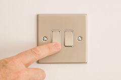 Double Lightswitch on a White Wall being pressed Royalty Free Stock Photo