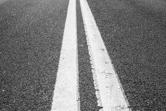 Double lines asphalt road royalty free stock photo