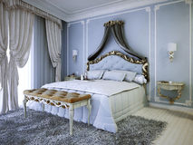 Double lit cher avec la tête de lit de tapisserie d'ameublement Photos stock