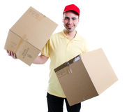 Double load. Delivery man holding two boxes Royalty Free Stock Photography