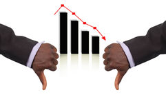 Double Losses. This is an image of two business hands representing Double Losses.This is indicated by the thumb down gesture and the drop in the graph Royalty Free Stock Photos