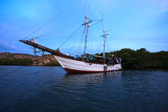 Double Masted Schooner in Pulau Rinco Indonesia Stock Photo