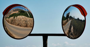 Double mirror. Double street mirror over a field in Italy Royalty Free Stock Image