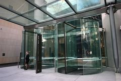 Free Double Modern Frameless Glass Revolving Doors Covered By Canopy Glazing To Office Building Lobby Royalty Free Stock Image - 132505686