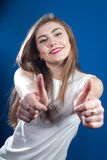 Double Okay, Young woman with thumbs up. Super Great, Young woman with two hands thumbs up on blue background Royalty Free Stock Photos