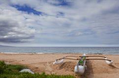 Double-outrigger Hawaiian Canoe. Outrigger adventure canoe on sandy ocean beach, Maui, Hawaii Stock Photo
