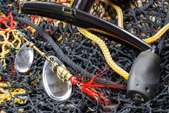 Double petal fishing bait with spinning reel and fish tank Royalty Free Stock Photos