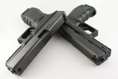 Double pistols. Dobule 9mm pistolson iluminated background Stock Image