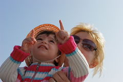 Double pointing. Little girl pointing at something with the fingers Royalty Free Stock Photos