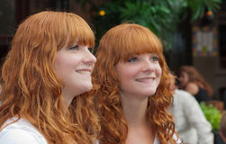 Double portrait of two redheaded girls. BREDA, NETHERLANDS – SEPTEMBER 4, 2011 : Redhead Day for young and old in the Dutch city of Breda. Thousands of Royalty Free Stock Images