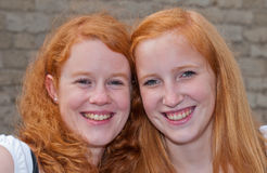 Double portrait of two redheaded girls. BREDA, NETHERLANDS – SEPTEMBER 4, 2011 : Redhead Day for young and old in the Dutch city of Breda. Thousands of Stock Image