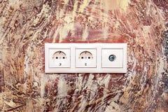 Double prise électrique avec la prise de TV Images stock
