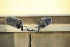 Double Professional sport microphone on a stadium. With windshield for live sport broadcasting Royalty Free Stock Image