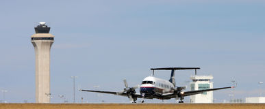 Double propeller plane on runway Stock Photos