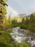 Double rainbow. Russia. Alatay. Rapid mountain river. Double rainbow Royalty Free Stock Photos
