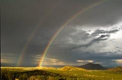 Double Rainbow. Over volcanoes in Northern Arizona Stock Photos