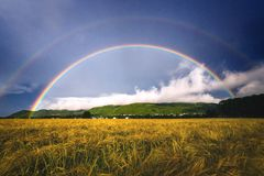 Double rainbow above agricultural fields in rural areas in Ranheim, Norway. Beautiful double rainbow on dark sky after the storm. Rural areas of Ranheim town in royalty free stock image