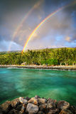 Double rainbow by the coast Stock Photography