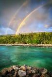 Double rainbow by the coast Stock Photography
